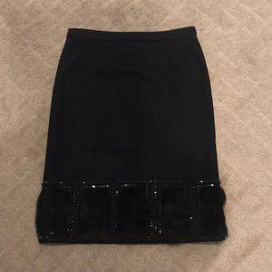 Black wool knee length  skirt with faux fur trim